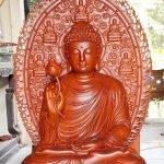 Tôn tượng Phật Thích Ca niêm hoa vi tiếu, lá đề sau lưng